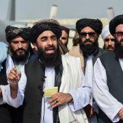 Taliban spokesman Zabihullah Mujahid addresses media at the Kabul airport on Aug. 31, 2021.
