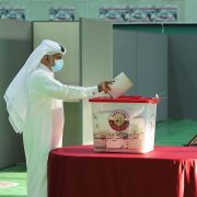 A man casts his ballot in Qatar's first-ever legislative vote at a polling station in Doha on Oct. 2, 2021.