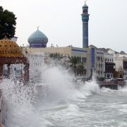 High waves break on the seaside promenade in Muscat on Oct. 2, 2021, the day before Cyclone Shaheen officially made landfall in Oman.