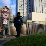 A security guard patrols outside a building that houses the NATO information office in Moscow on Oct. 18, 2021, after Russia announced it was ending the country's mission to the Western military alliance.