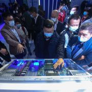 Visitors look at Alibaba's new servers at the company's annual cloud computing conference in Hangzhou, China, on Oct. 19, 2021.