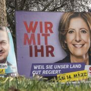 Campaign billboards featuring candidates from Germany's Social Democratic Party (right) and Christian Democratic Union (left) are seen in Mainz, Germany, ahead of Rhineland-Palatinate state elections.