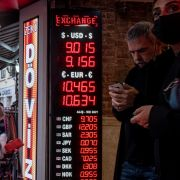 People line up at a currency exchange in Istanbul on Oct.14, 2021, after the firing of central bank officials caused the Turkish lira to drop to a new low against the U.S. dollar.