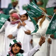 Fans of the Saudi national football team cheer during a match against Qatar at the King Fahad International Stadium in Riyadh, Saudi Arabia, on Nov. 26, 2014.