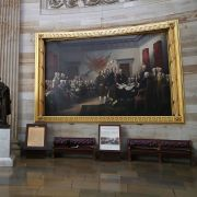 """John Trumbull's famous """"Declaration of Independence"""" painting hangs on a wall inside the U.S. Capitol in May 2017."""