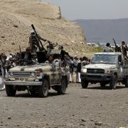 Houthi-allied tribesmen ride trucks mounted with machine guns on the outskirts of Sanaa, Yemen, on July 8, 2020.