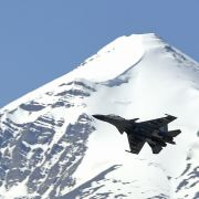 An Indian fighter jet flies over a mountain range near the disputed territory of Ladakh on June 23, 2020.