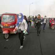 Iraqis run for cover during an anti-government demonstration in Baghdad on Jan. 23, 2020. Protests have rocked Iraq since October but recently had abated amid spiraling tensions between the country's key allies, the United States and Iran.