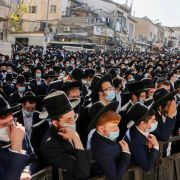Ultra-Orthodox Jewish men attend the funeral of Rabbi Aharon David Hadash, the spiritual leader of the Mir Yeshiva, in Jerusalem's ultra-Orthodox neighborhood of Beit Yisrael on Dec. 3, 2020.