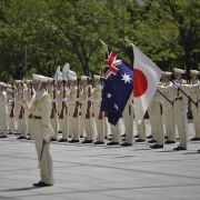 A Japanese honor guard welcomes the Australian defense minister during a visit in August 2016.