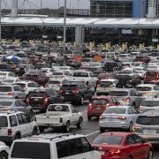 Cars line up on the Mexican side of the San Ysidro crossing port at the U.S.-Mexico border in Tijuana, Mexico, on March 12, 2020.