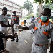 A photo of a security official administers hand sanitizer in Lagos, Nigeria, on Feb. 28, 2020. The city's 20 million residents scrambled for hygiene products following the announcement of the first confirmed coronavirus case in sub-Saharan Africa.