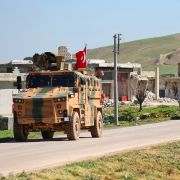 A column of armored Turkish military vehicles proceeds along a road in a demilitarized zone in the western countryside of Syria's Aleppo province on March 8, 2019.