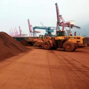 A worker moves soil containing rare earth minerals at a port in China.