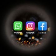 The logos of the U.S.-based social media platforms WhatsApp, Instagram and Facebook (left to right) are seen on a smartphone screen in Moscow, Russia, on Oct. 5, 2021.