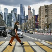 This photo shows a woman crossing a street near downtown Moscow, Russia.
