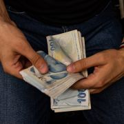 A currency exchange worker counts lira banknotes in Istanbul, Turkey, on Aug. 6, 2020.