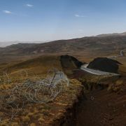 A picture taken on Aug. 16, 2021, shows the landscape of Iran behind a section of the newly completed wall on Turkey's eastern border in Caldiran.