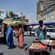 Afghan women shop at a market area in Kabul on Aug. 23, 2021, following the Taliban's takeover of the country.