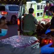 Medical staff bring an injured man to a hospital after a deadly militant attack Aug. 26, 2021, outside Hamid Karzai International Airport in the Afghan capital of Kabul.