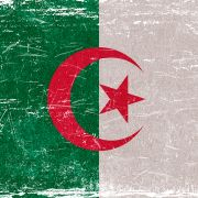 An image of the Algerian flag. Plummeting oil demand and prices due to the COVID-19 crisis have sapped the Algerian government of its primary revenue source.