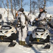 Norwegian army soldiers use snowmobiles for mobility during a military exercise on March 6, 2013, in Skjold, Norway.