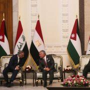 Iraqi Prime Minister Mustafa al-Kadhimi, Jordan's King Abdullah II, Iraqi President Barham Saleh and Egyptian President Abdel Fattah al-Sisi (from left to right) meet in Baghdad on June 27, 2021.
