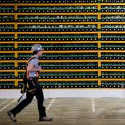 A worker passes a bitcoin mining operation in Quebec in March 2018.