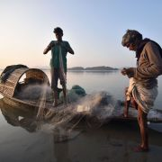 Fishermen get ready to cast their net on the Brahmaputra River, part of a massive river system that India shares with China, Nepal, Bhutan and Bangladesh.