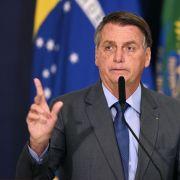 Brazilian President Jair Bolsonaro speaks during a press conference on July 27, 2021.