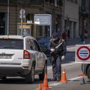 A traffic officer enforces a confinement order in Barcelona on April 6, 2020.