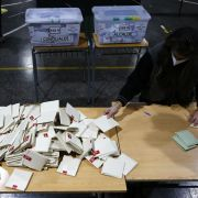 A poll worker counts votes cast for constitutional convention representatives in Santiago, Chile, on May 16, 2021.