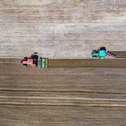An aerial photo shows villagers sowing highland barley seeds with agricultural machinery in the fields in Lhasa, the capital of China's Tibet Autonomous Region, on April 22, 2020.