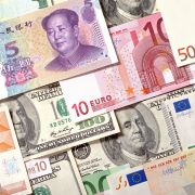This photo illustration displays currencies of China, the European Union and the United States.
