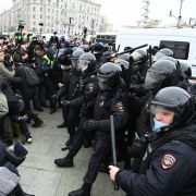 Protesters clash with riot police during a rally in support of jailed opposition leader Alexei Navalny in Moscow, Russia, on Jan. 23, 2021. Navalny was detained upon returning to Moscow after spending five months in Germany recovering from a near-fatal poisoning.