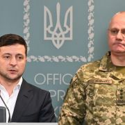 Ukrainian President Volodymyr Zelenskiy speaks following an outbreak of violence with pro-Russian separatists in eastern Ukraine on Feb. 18, 2020. Ruslan Khomchak, the commander of Ukraine's armed forces, stands behind Zelenskiy.