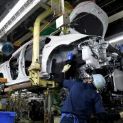 Workers in Toyota City in Japan's Aichi prefecture assemble a Prius. Japan's auto manufacturing sector is heavily export-driven, and the United States is a prime destination for its cars.