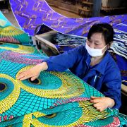As its economy matures, China has attempted to move up the value chain in manufacturing, beyond industries such as textiles and into high-tech development.