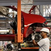 Workers assemble cars at the Nissan plant in Resende, Brazil, during February 2015. Most major automakers have factories in Brazil and Argentina.