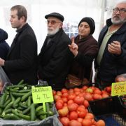 People line up to buy discounted vegetables sold by municipal authorities in Ankara, Turkey, on Feb. 13, 2019.