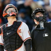 Baseball player Nick Hundley and umpire Jeff Kellogg watch a drone flying over Detroit's Comerica Park in 2014.