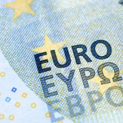 A close-up of a five-euro banknote.
