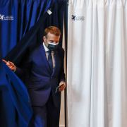 French President Emmanuel Macron leaves the polling booth after voting June 20, 2021, in Le Touquet, France.