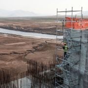 A worker goes down a construction ladder at the Grand Ethiopian Renaissance Dam on the Blue Nile in Ethiopia on Dec. 26, 2019.