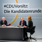 German journalist Tanja Samrotzki (right) moderates a panel with the candidates vying for the leadership post of Chancellor Angela Merkel's Christian Democratic Union (CDU) party -- Friedrich Merz, Norbert Roettgen and Armin Laschet (from left to right) -- on Dec. 14, 2020, in Berlin, Germany.