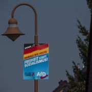 "A campaign poster for the far-right Alternative for Germany (AfD) reads ""Freedom instead of socialism"" in Krewelin, Brandenburg, ahead of state elections on Sept. 1, 2019."
