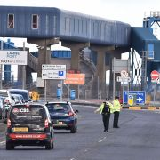 Officers man a checkpoint at a harbor in Larne, Northern Ireland, on Feb. 10, 2021.