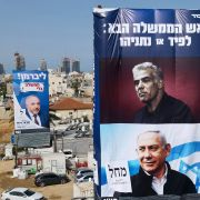 Campaign posters hang over a construction site in Bnei Brak, Israel, on March 14, 2021.