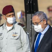 Israeli Prime Minister Benjamin Netanyahu (right) and military chief Lt. Gen. Aviv Kochavi attend a graduation ceremony for new pilots at an air force base near the southern Israeli city of Beersheba on June 25, 2020.