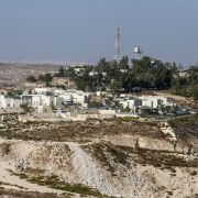 A picture taken on October 14, 2020, shows the Israeli Shimaa settlement south of the city of Hebron in the occupied West Bank, with the Palestinian village of Samua in the background.